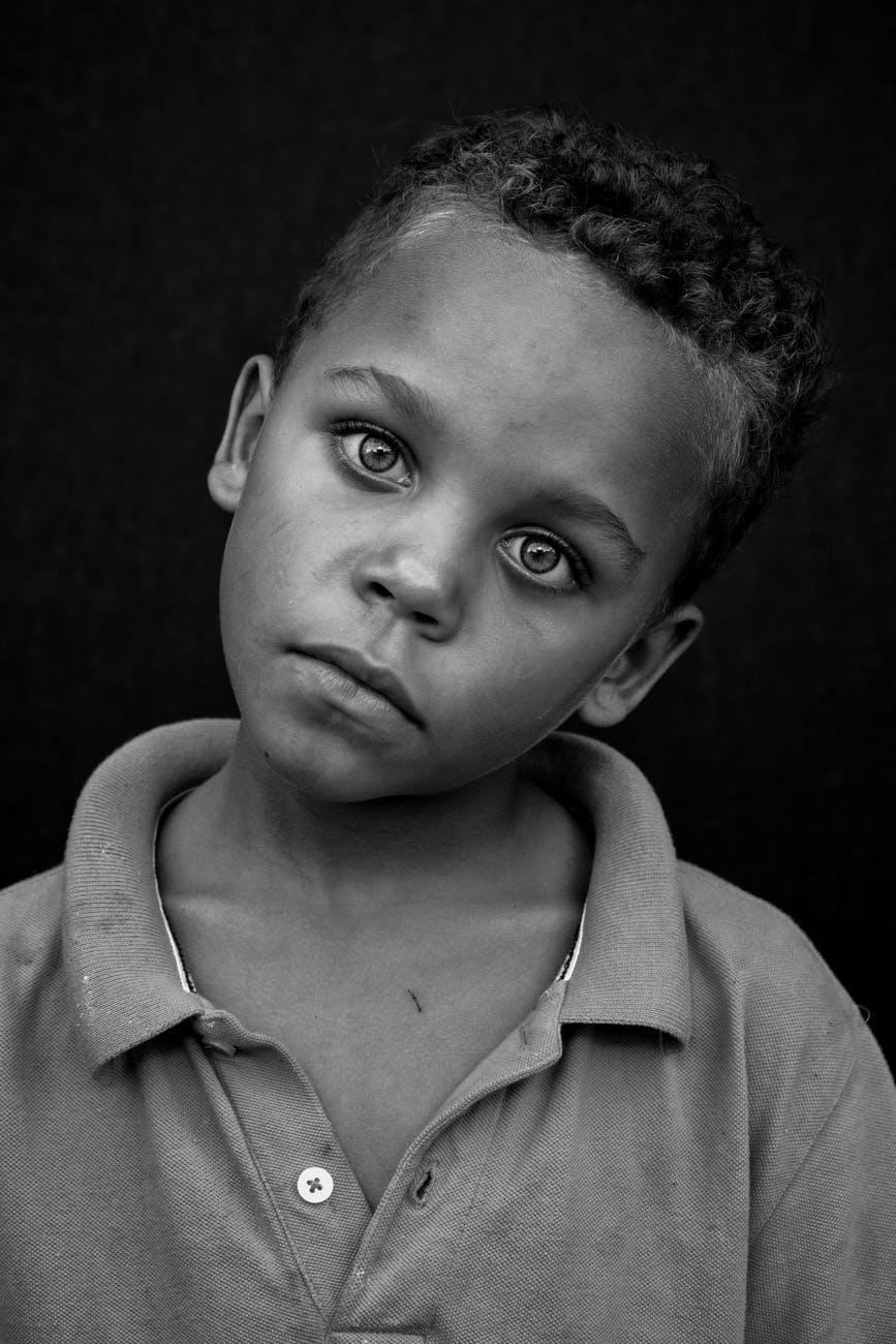 boy in polo shirt greyscale portrait
